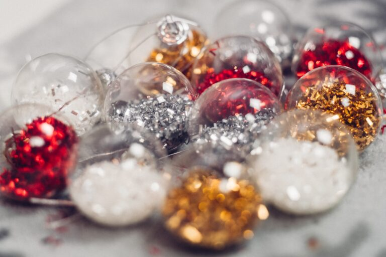 Holiday ornaments filled with sparkly decorations